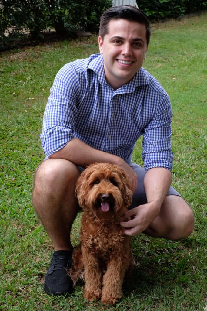 Chris the creator of oodle life and his Labradoodle puppy Max